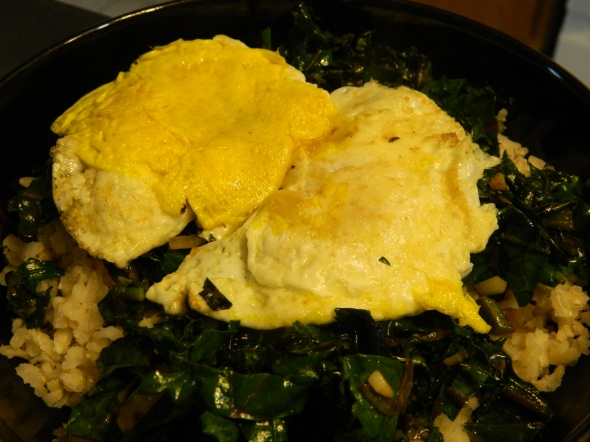 Leftover rice, sauteed kale from garden w/Braggs and two of my hens eggs